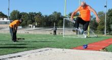 man leaping in long jump